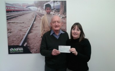 Mark Barker presents raffle cheque to Railway Children